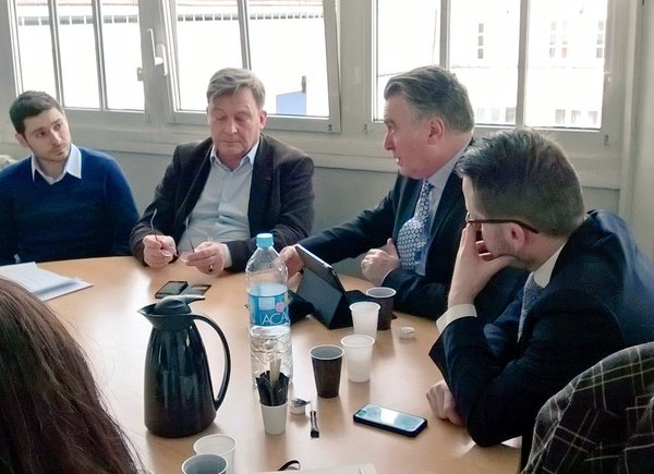 Members of the UK delegation discuss migration issues with Terre d'Asile