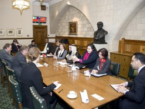 Richard Ottaway MP and Sir John Stanley discuss foreign affairs with delegation