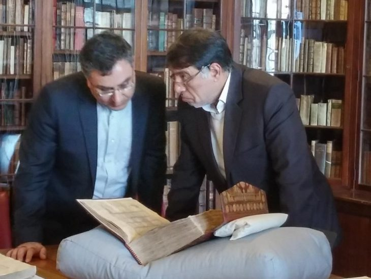 Dr Mansouri inspects an exhibition of Persian manuscripts at the University of Cambridge Library
