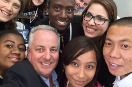 Lord McConnell takes a selfie with members of Restless Development calling for youth voices to be heard