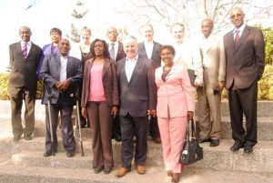The APPG delegation with Members of the Rwanda Parliament on the step of the Parliament