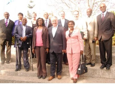The APPG delegation with Members of the Rwanda Parliament on the step of the Parliament.jpg