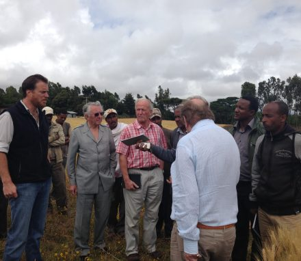 The Delegation discussing crop methods with farmers near Butajira.jpg