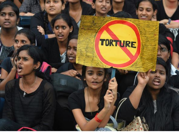 Indian college students taking part in a protest on the occasion of the UN International Day in Support of Victims of Torture. © AFP PHOTO/ Manjunath Kiran