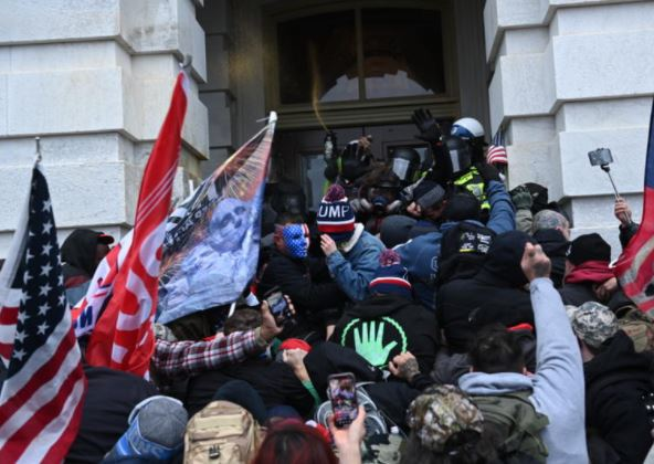 Trump supporters clash with police as they storm the US Capitol on 6 January 2021. Brendan Smialowski/ AFP