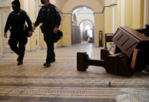Clearing the damage inside the US Capitol building early on 7 January 2021. OLIVIER DOULIERY / AFP
